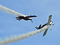 Stunt planes fooling around over Elmendorf (5232152109).jpg