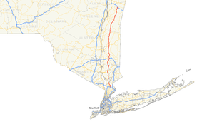A map showing the southern portion of New York State. Major roads are highlighted in blue. One road running north–south near the east is highlighted in red.