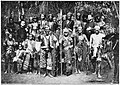 The Datto Manib, principal Bagani of the Bagobos, with some wives and followers and two missionaries (c. 1900, Philippines).jpg