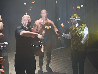 Tommaso Ciampa - Ciampa (center) with Ernie Osiris (left) and Prince Nana (right) as part of The Embassy in 2011