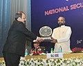 The Minister of State for Home Affairs, Shri Hansraj Gangaram Ahir being felicitated by the Director General, NIA, Shri Y.C. Modi, during the National Investigation Agency (NIA) Day function, in New Delhi on January 24, 2018.jpg