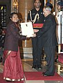 The President, Shri Pranab Mukherjee presenting the Arjuna Award for the year-2014 to Ms. Yumanam Renu Bala Chanu for Weightlifting, in a glittering ceremony, at Rashtrapati Bhavan, in New Delhi on August 29, 2014.jpg