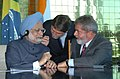 The Prime Minister Dr. Manmohan Singh interacting with the President of Brazil Mr. Luiz Inacio Lula da Silva, during the signing of agreements at the Alvorada Palace, in Brasilia, Brazil, on September 12, 2006.jpg