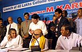 The Union Minister Communication & Information Technology Shri Dayanidhi Maran clapping while the Chief Minister of Karnataka Shri Dharam Singh and the former Chief Minister of Tamil Nadu Shri M. Karunanidhi talk to each other on.jpg