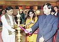 The Union Minister for Textiles Shri Syed Shahnawaz Hussain lighting the lamp to inaugurate the Shawl Show 2003 an exhibition of classic handwoven shawls and scarves in wool, cotton, Silk and blands, in New Delhi on December 22.jpg