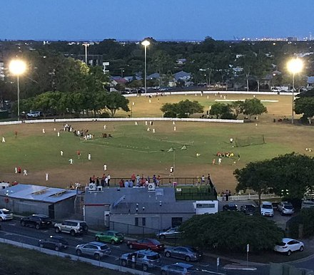 Toombul District Cricket Club, with LaFrantz Oval in the background, Ken Mackay Oval in the foreground, and The Yard Bar rooftop overlooking the field Toombul Cricket Club aerial view.jpg