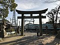 Torii of Enoki Shrine and train of Nishitetsu Tenjin-Omuta Line.jpg