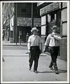 Two men in shirtsleeves in June 1919. Tavern sign at southwest corner of Twelfth and Olive proclaims the imminent imposition of the first stage of Prohibition.jpg