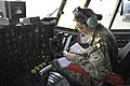 U.S. Air Force Capt. Keri Morris, a C-130H Hercules aircraft co-pilot, consults charts before a flight out of Bagram Airfield, Parwan province, Afghanistan, Jan. 9, 2014 140109-F-BJ707-082.jpg