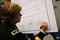 U.S. Army Brig. Gen. Marianne Watson, the director of Manpower and Personnel at the National Guard Bureau (NGB), signs the agreement between the NGB and the Corporation for National Community Service for the NGB 130315-Z-TU749-032.jpg