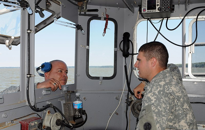 U.S. Army Sgt. Michael Southards, left, a watercraft engineer with ...