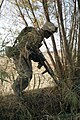 U.S. Marine Corps Lance Cpl. Christopher G. Chestnut, a rifleman with Golf Company, 2nd Battalion, 2nd Marine Regiment, jumps across a canal during a patrol through the fields and town of Amir Agha in 091202-M-EK802-002.jpg
