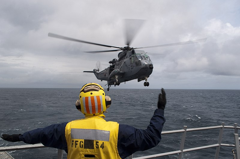 File:U.S. Navy Boatswain's Mate 3rd Class Wesley Malcher guides a Royal Canadian Navy CH-124 Sea King helicopter for landing on the guided missile frigate USS Ford (FFG 54) during Exercise Trident Fury 2013 130513-N-QY316-028.jpg