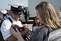 U.S. Navy Chief Logistics Specialist Manuel Vidaurri, left, assigned to the guided missile destroyer USS Momsen (DDG 92), holds his newborn baby on the pier at Naval Station Everett, Wash., Aug. 22, 2013 130822-N-MM360-184.jpg