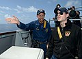 U.S. Navy Cmdr. John D. Stoner, left, the commanding officer of the guided missile destroyer USS Ramage (DDG 61), instructs Ensign Matthew Taber, a conning officer, as the ship conducts small boat operations 140409-N-CH661-625.jpg