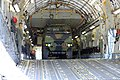 U.S. Soldiers and Airmen assigned to the Hawaii Army and Air National Guard secure a vehicle to the cargo bay of a C-17 Globemaster III aircraft during exercise Makani Pahili at Joint Base Pearl Harbor-Hickam 130601-Z-UX415-079.jpg