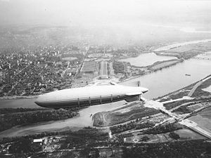 "Columbia Island (District of Columbia) - The dirigible USS Akron flies over Columbia Island in 1931. Below and to the right of the airship's tailfins is the island, on which extensive construction is under way on the ""great plaza"", axial roads, Boundary Channel Bridge, and Memorial Drive. Note the lack of any bridges to the north (left in this image)."