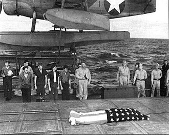 Walden L. Ainsworth - USS Helena (CL-50) survivors after their ship was sunk on July 6, 1943 hold a funeral service for Irwin Edwards aboard the USS Honolulu (CL-48). Edwards died of his wounds after being rescued. Admiral Walden Ainsworth, cap off center, provided comments.