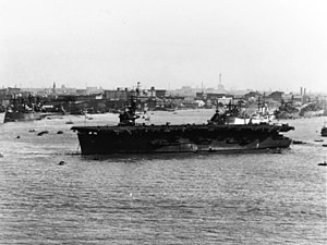 USS Anzio (CVE-57) lies at Shanghai, China, 1 December 1945.jpg