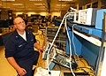 US Navy 030313-N-7535G-009 Aviation Electronics Technician 3rd Class M. Clay Henry makes adjustments on his Oscilloscope which is used for general-purpose electronic repairs.jpg