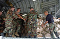 US Navy 050109-N-4267W-065 Seabees assigned to Naval Mobile Construction Battalion Seven (NMCB-7), with the assistance of U.S. Air Force personnel, load pallets of relief supplies and equipment into a C-17 Globemaster III airc.jpg