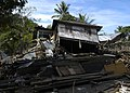 US Navy 050117-N-9951E-004 A house lies nearly on its side in the region of Glebruk, one of the coastal towns hit by the massive Tsunami that struck December 26, 2004.jpg