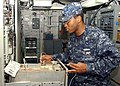 US Navy 050218-N-4208W-004 Electronics Technician 3rd Class Wayne A. Ross conducts maintenance on the WSC-3 Demand Access Multiple Assignment System aboard the amphibious assault ship USS Tarawa (LHA 1).jpg