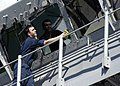 US Navy 050224-N-6616W-001 Quartermaster Seamen John S. Lindsay Of Margate, Fla., washes the windows of the pilothouse aboard the amphibious assault ship USS Saipan (LHA 2) after pulling into Naval Station Guantanamo Bay, Cuba.jpg
