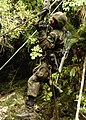 US Navy 050817-N-1261P-135 U.S. Navy Hospital Corpsman 2nd Class Danny L. Hawkins slides across a river using a pulley system as part of an obstacle course at the Jungle Warfare Training Center.jpg