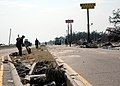 US Navy 050830-N-0553R-001 U.S. Navy Seabees from Construction Battalion Center, Gulfport, Miss., remove debris left by Hurricane Katrina on U.S. Highway 90 in Gulfport.jpg