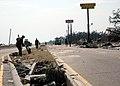 US Navy 050830-N-0553R-001 U.S. Navy Seabees from Construction Battalion Center, Gulfport, Miss., remove debris left by Hurricane Katrina on U.S. Highway 90 in Gulfport.jpg