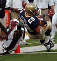 US Navy 050903-N-9693M-001 U.S. Naval Academy Midshipman 1st Class Marco Nelson falls over the goal line in the first quarter as Maryland Terepin defender Josh Wilson tries to block.jpg