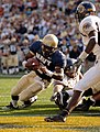 US Navy 051015-N-9693M-013 U.S. Naval Academy Midshipman Quarterback Lamar Owens rushes for a touchdown in the 4th quarter against the Kent State Golden Flashes.jpg