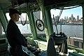 US Navy 051203-N-4936C-002 Boatswain Mate 1st Class Daniel Durham maneuvers YP 698 as he approaches the pier at Penn's Landing in Philadelphia.jpg