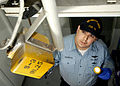 US Navy 070508-N-7981E-004 Culinary Specialist Seaman Ryan P. Anderson, of supply department's S-13 maintenance division, uses a telescoping mirror to check overhead fixtures for signs of corrosion.jpg