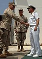 US Navy 070522-N-2653P-003 New Joint Task Force- Guantanamo commanding officer, Rear Adm. Mark H. Buzby shakes hands with Commander, United States Southern Command, Adm. James Stavridis.jpg