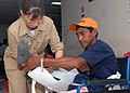 US Navy 070629-N-4238B-031 Cmdr. Patricia Corley, a clinical nurse assigned to Military Sealift Command hospital ship USNS Comfort (T-AH 20), wraps the leg of a patient at Puerto Barrios National Hospital.jpg