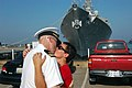 US Navy 070801-N-4014G-044 A Sailor assigned to guided missile destroyer USS Porter (DDG 78) kisses his spouse good-bye prior to boarding Porter to depart for a six-month deployment.jpg