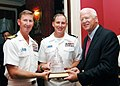 US Navy 070924-N-2100S-002 Georgia Senator Saxby Chambliss and the Nimitz-class nuclear-powered aircraft carrier USS Carl Vinson (CVN-70) Commanding Officer, Capt. Ted Carter, present Chief Warrant Officer 3 Kenneth Knowlton wi.jpg