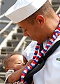 US Navy 070926-N-6295H-005 Cryptologic Technician (Technical) 1st Class Leon Poulson IV, assigned to dock landing ship USS Harpers Ferry (LSD 49), embraces his son for the first time after returning from patrol in the Western P.jpg