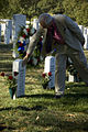 US Navy 071021-N-5319A-040 Daniel Murphy, father of Navy SEAL Lt. Michael Murphy touches the gravestone of Electronics Technician 1st Class Jeffrey Lucas, during a visit to Arlington National Cemetery.jpg