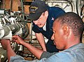 US Navy 071116-N-0000X-001 Machinist's Mate 2nd Class Luke Vontagen, a diesel technician assigned to USS Annapolis (SSN 760), works with a Cape Verdean Coast Guardsman to repair a propulsion engine.jpg