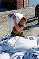 US Navy 080915-N-7955L-080 Hospital Corpsman Shane Leidig, embarked aboard the amphibious assault ship USS Kearsarge (LHD 3), carries supplies during a humanitarian assistance mission in Haiti.jpg