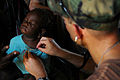 US Navy 080917-N-4515N-201 Capt. Timothy Shope listens to a young girl's heart and lungs.jpg