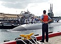 US Navy 090129-N-9486C-052 A Sailor stands at parade rest as the fast-attack submarine USS Bremerton (SSN 698) is assisted to a pier at Naval Station Pearl Harbor.jpg