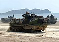 US Navy 090629-N-5207L-232 Amphibious assault vehicles transport U.S. Marines and Malaysian Army soldiers from the 9th Royal Malay Regiment along Resang Beach.jpg