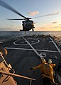 US Navy 090710-N-4236E-186 Boatswain's Mate 2nd Class Michael Trapps and Boatswain's Mate 2nd Class Jason Goedhart direct an MH-60S Sea Hawk helicopter from Helicopter Sea Combat Squadron (HSC) 22 during deck landing qualificat.jpg
