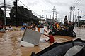 US Navy 090927-N-0120R-002 U.S. Navy SEAL Teams One and Seven, Naval Special Boat Teams 12 and 20, and medical personnel assigned to Joint Special Operations Task Force-Philippines rescue Manila residents after flooding destroy.jpg
