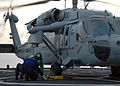 US Navy 091117-N-7058E-333 Flight deck crewmen from USS Freedom (LCS 1) secure a MH-60S Sea Hawk helicopter.jpg