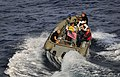 US Navy 100409-N-4774B-032 ailors assigned to the guided-missile cruiser USS Bunker Hill (CG 52) use a rigid-hull inflatable boat to recover an exercise torpedo during a test of the torpedo launch system.jpg